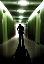 Psychiatrist walking alone down hallway